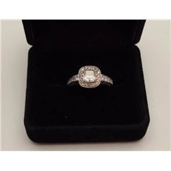 One 1.03ct princess cut diamond Color I  clarity SI-1 set in a 18ct white gold halo  design ring. Sh