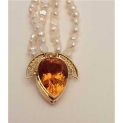 One 20 ct pear shape Madera citrine pendant  in 18 k yellow gold in art deco style  attached to a do