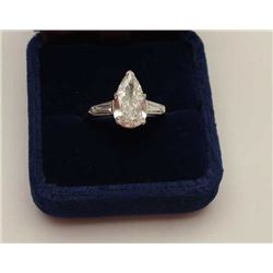 2.05 CT pear shape diamond mounted in  platinum with tapered baguettes totaling  approximately .50.