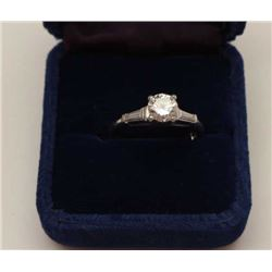 .85 round brilliant diamond set in platinum  with 2 side baguettes of approximately .10PT  each. The