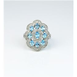 Intricate Vintage design ladies ring set with  nine oval blue Topaz weighing approx. 3.00  carats an