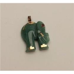Carved jade elephant with red stone eye and  gold mounts. Vintage 1950s-60s. Estate  consigned. Est.