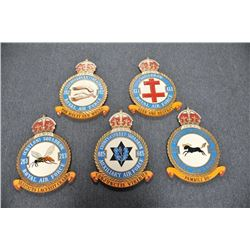 """Lot of 5 carved and painted wooden R.A.F.  Squadron plaques, each approximately 18"""" X  13"""" overall."""