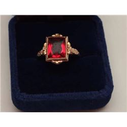 Unidentified orange-red cut stone in antique  gold unmarked mount. 10-18k. Estate  consigned. Note: