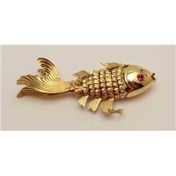 1960's Asian made gold fish pendant. Cut  stone eyes. 14k-18k. Estate consigned. 10  grams. Est.: $1