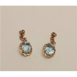 Blue topaz in 14K earrings. Rope design and  not marked. Estate consigned. Est.: $