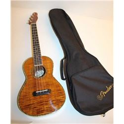"Fender Koa wood Ukulele with telecaster  headstock and black Fender ""gig"" bag; in  overall very good"
