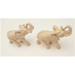 "Pair of faux ivory elephants, approximately  8"" in height and 9"" in length each.           Est.:  $5"