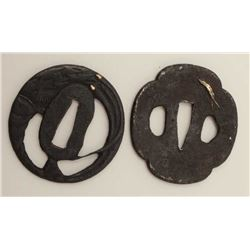 Two iron tsuba. One inlaid with gilt copper  snake and badger. The other pierced and  chiseled with