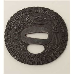 Large iron tsuba beautifully chiseled in  relief with dragon and pearl. A masterpiece  of the ironwo