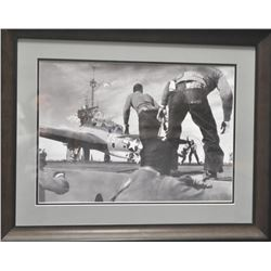 Large framed and matted action scene on deck  of a U.S. aircraft carrier with plane about  to launch