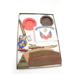 Large riker case of U.S. military items  including soft caps, U.S.M.C. silk banner,  ashtrays, cigar