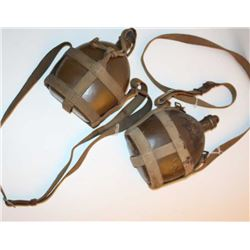 Lot of 2 WW II canteens with woven shoulder  straps.       Est.:  $75-$150.