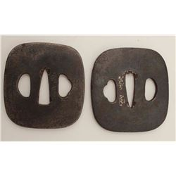 A matched pair of iron tsuba. Both well  signed by the same artist. One slightly  larger than the ot