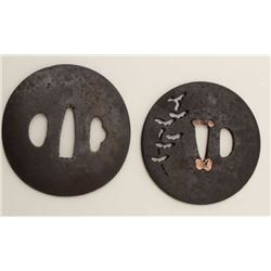 Two large iron tsuba. One pierced with cedar  trees has remains of signature. The other  finely forg