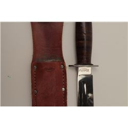 """""""Kinfolks"""" brand U.S. pattern fighting knife  with scabbard and plated blade. In very good  to almos"""