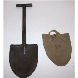 WW II T-handled entrenching shovel with tan  woven U.S.-marked cover.       Est.:   $50-$75.