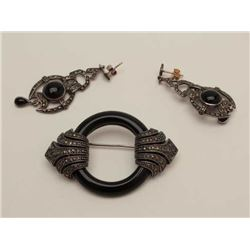One Victorian  set of onyx and marquisate  brooch and earrings in sterling silver   Est:$150-200