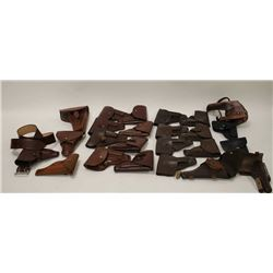 Large lot of military style flap holsters;  Eastern Europe; post-WW II and some  reproductions.    E
