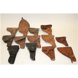Large lot of military holsters; European,  U.S.; WW II to 1950's.     Est.:  $150-$300.