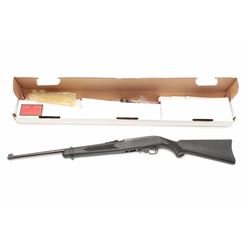 Ruger 10/22 Semi-Auto rifle with neoprene  stock, green and red sights. Like new in box,  S/N 821-72