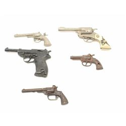 Lot of 4 misc. older cap guns and a solid  non-gun metal copy of a P-38 pistol.      Est.:  $100-$20