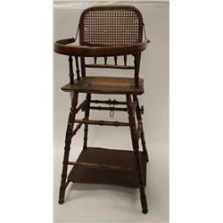 "Antique wood and wicker child's high chair  with feeding tray, approximately 39"" in  height; in over"