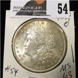 1899 O Morgan Dollar MS 63 gold toning on rev