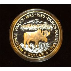 1885-1985 Canada 'Moose' Proof .500 fine Silver Dollar encased in plastic.