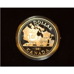 1981 Canada 'Transcontinental Railroad' Proof .500 fine Silver Dollar encased in plastic.