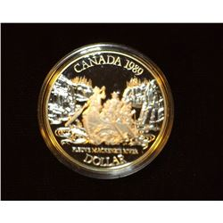1989 Canada 'Mackenzie River' Proof .500 fine Silver Dollar encased in plastic.
