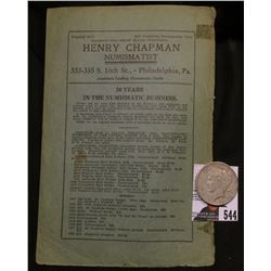 "Early advertising card ""Henry Chapman Numismatist, Philadelphia, Pa."" and 1922 S U.S. Silver Peace D"
