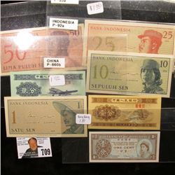 (7) Pieces of Currency from Indonesia, Hong Kong and China. Mostly Uncirculated.