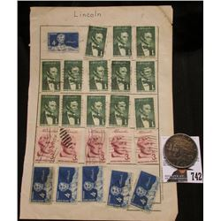 Stamp Sheet of various 'Lincoln' Postage Stamps; & 1922 D U.S. Peace Dollar, VF with dark original t