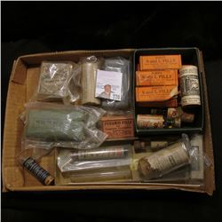 A nice selection of Old Medicine Bottles and Boxes.