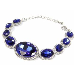 Ladies Custom Bracelet. 1 Prong, Oval Blue Swarovs