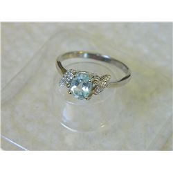 RING - OVAL FACETED LIVELY SKY BLUE TOPAZ & 2 DIAMONDS IN STERLING SILVER SOLITAIRE DESIGNED SETTING
