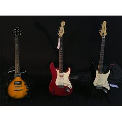 3 GUITARS: EPIPHONE STRAT STYLE ELECTRIC GUITAR WITH BRIDGE POSITION HUMBUCKER PICKUP AND SOFT