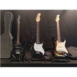 3 GUITARS: ROK AXE, BURSWOOD, AND GK STRAT STYLE ELECTRIC GUITARS, WITH ONE HARD SHELL AND ONE SOFT
