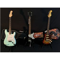 3 GUITARS: SQUIER BULLET STRAT WITH SOFT SHELL CASE, FIRST ACT DOUBLE CUT LES PAUL JUNIOR STYLE