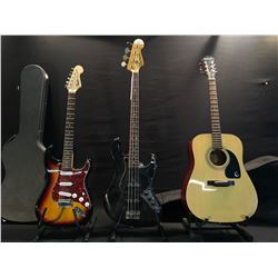 3 GUITARS: SQUIER JAZZ BASS, EPIPHONE PR 100 ACOUSTIC GUITAR WITH SOFT SHELL CASE, AND SQUIER STRAT