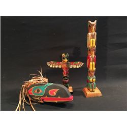 THREE SMALL HAND CARVED AND PAINTED FIGURES INC. HAWK MASK, THREE FIGURE TOTEM POLE, AND TWO