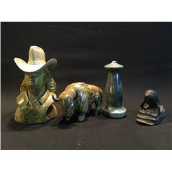 FOUR HAND CARVED STONE SCULPTURES BY LESLIE HAMPTON, OF DOLPHIN, CHESS PIECE, BUFFALO, AND COWBOY,