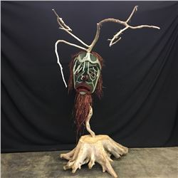 LARGE HAND CARVED AND PAINTED WILDMAN MASK MOUNTAIN IN WOODEN STUMP BASE, BY DAVE JACOBSON OF FORT
