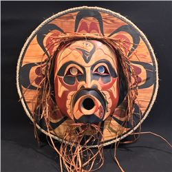 "HAND CARVED AND PAINTED ""WILDMAN OF THE WOODS"" MASK ON ROUND PANEL, BY HUBERT BILLY, 23'' W"