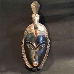AFRICAN HAND CARVED MASK OF A WOMAN, APPROX. 16'' H