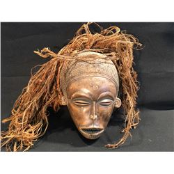 AFRICAN HAND CARVED MASK OF A WOMAN, APPROX. 10'' H
