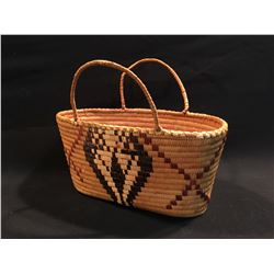 B.C. FIRST NATIONS HAND WOVEN BASKET, 17'' L  X 8.5'' W X 13.5'' H