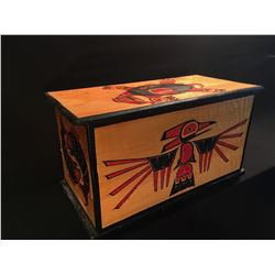LARGE HAND CARVED AND PAINTED LIDDED BOX, FEATURING RAVEN, TURTLE, AND SALMON IMAGERY, 34.5'' W X