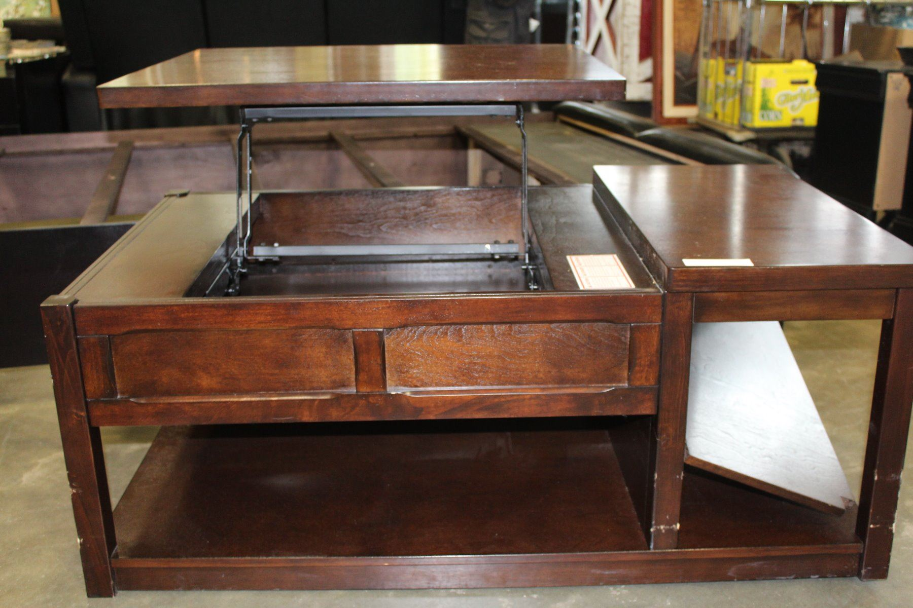 modern rolling lift top coffee table big valley auction. Black Bedroom Furniture Sets. Home Design Ideas